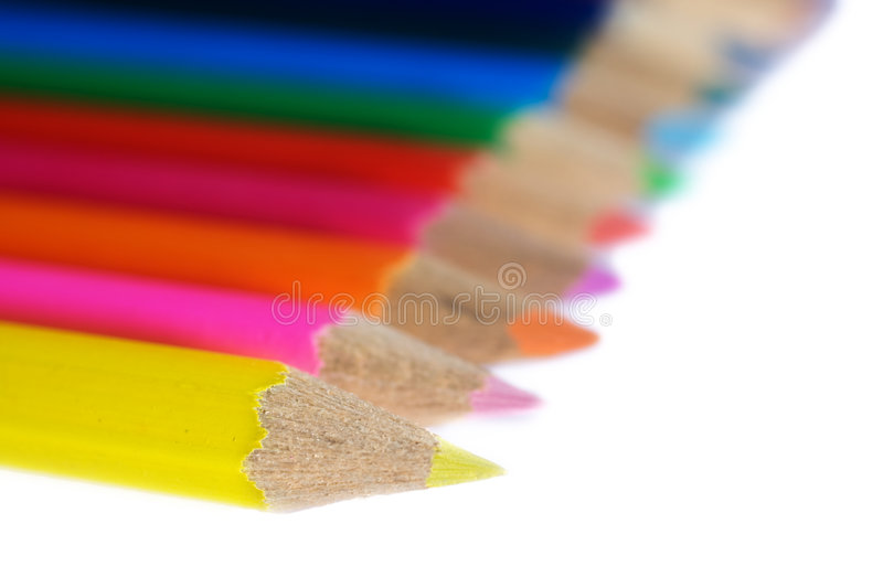 Sharpened Colored Pencils. A closeup of the sharpened tips of wooden colored pencils with a narrow depth of field and the focus on the first pencil royalty free stock photos