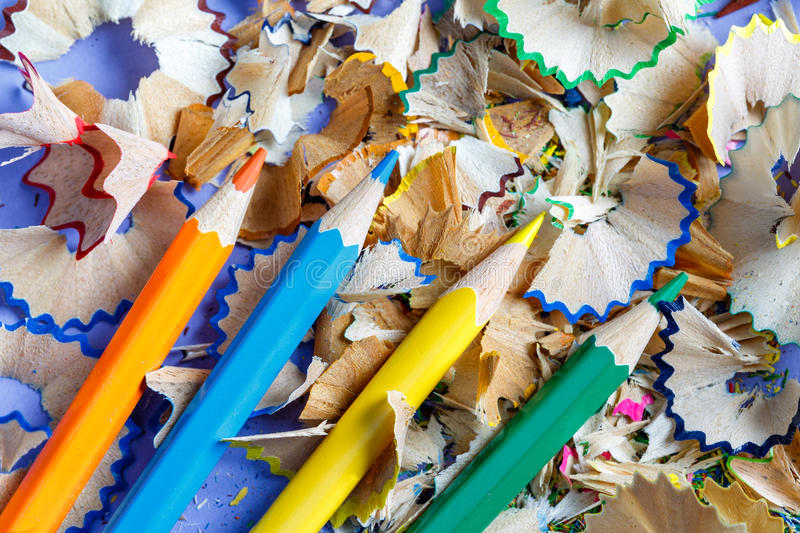 Sharpened colored pencils and pencil shavings royalty free stock photo