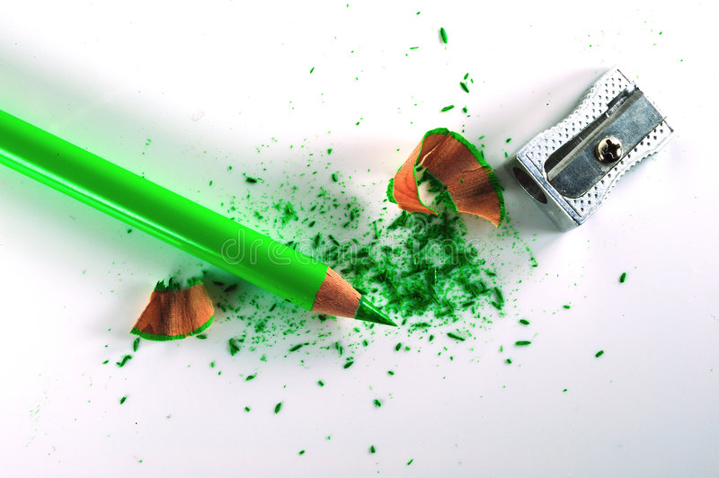 Sharpened pencil. With a hand-spun pencil sharpener and some shavings stock image