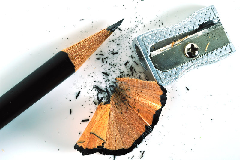 Sharpened pencil. With a hand-spun pencil sharpener and some shavings royalty free stock photo