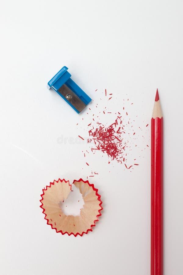 Sharpened pencil, shavings and sharpener royalty free stock photos