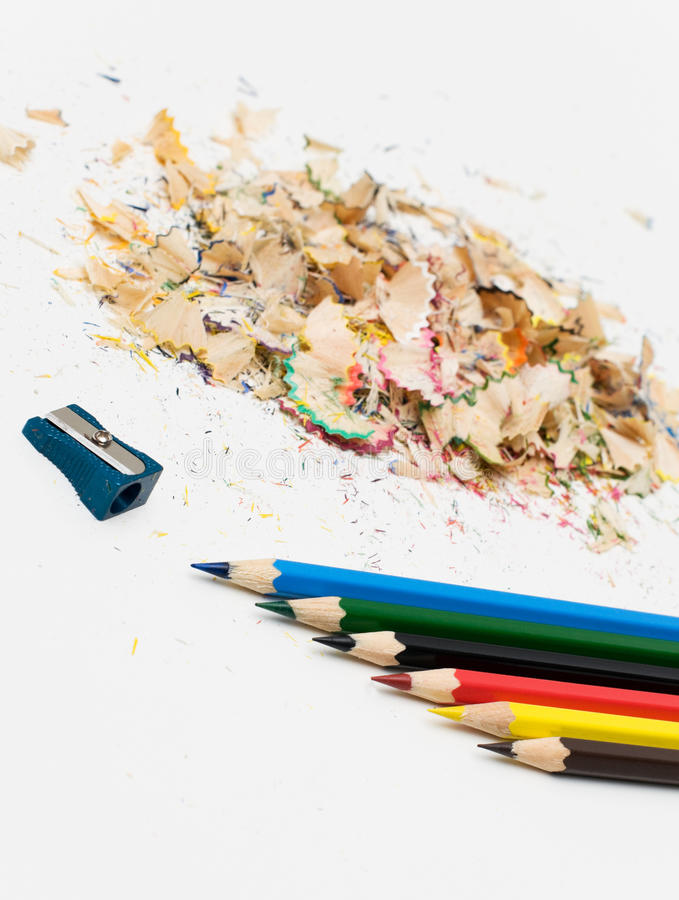 Sharpened pencil and wood shavings. Six Sharpened pencil and wood shavings. Office stock image