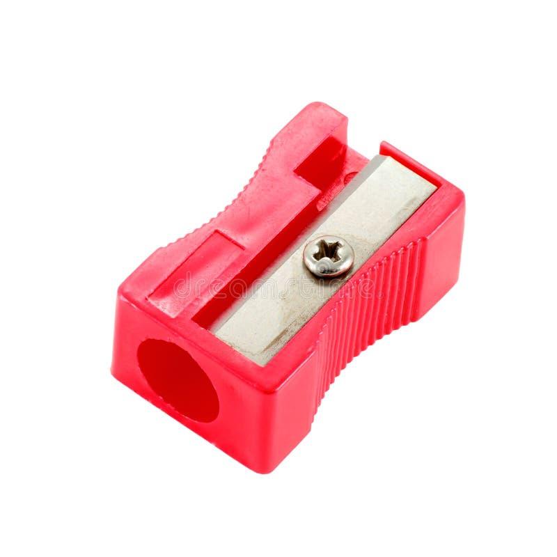 Sharpener. Red plastic sharpener on a white background stock photo