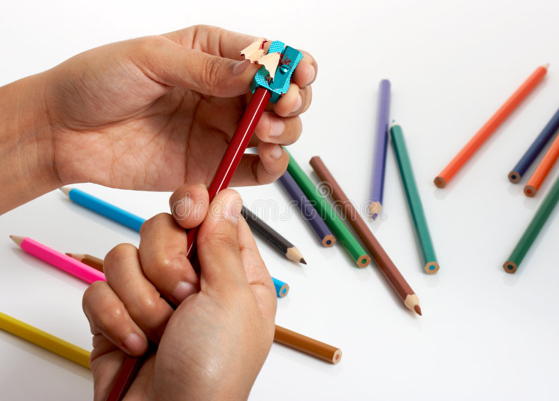 Sharpening. A colored pencil with a blue sharpener royalty free stock photography