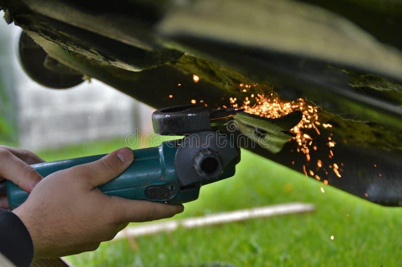 Sharpening mower blades stock photo