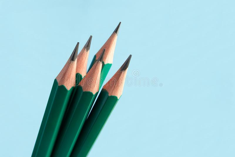 Sharply sharpened simple pencils with graphite rod, on blue back stock images