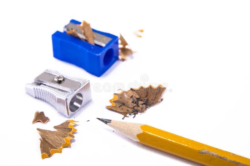 Sharpner manual del lápiz en el fondo blanco fotografía de archivo