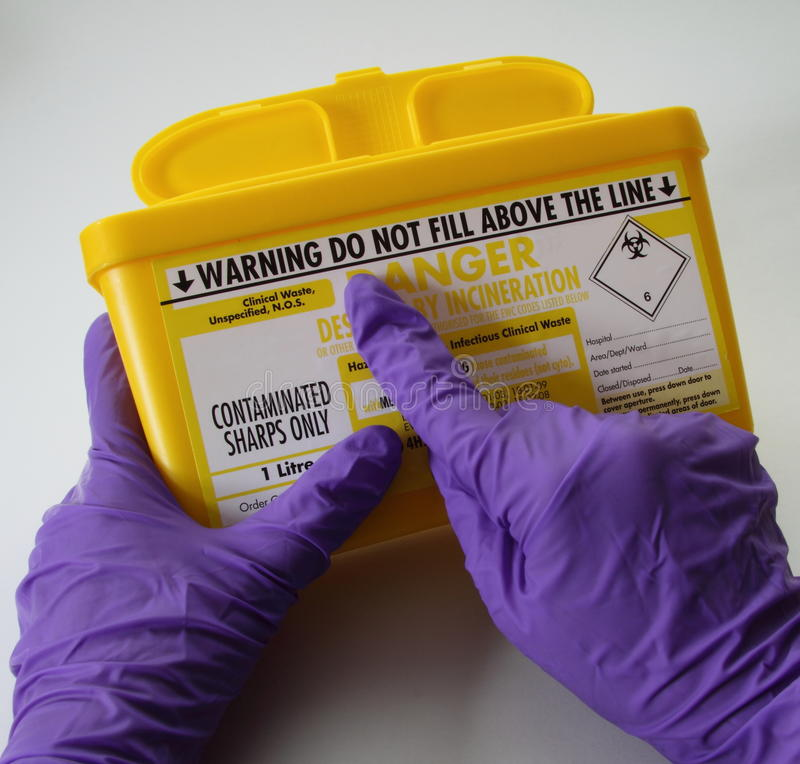 Sharps container warning royalty free stock image