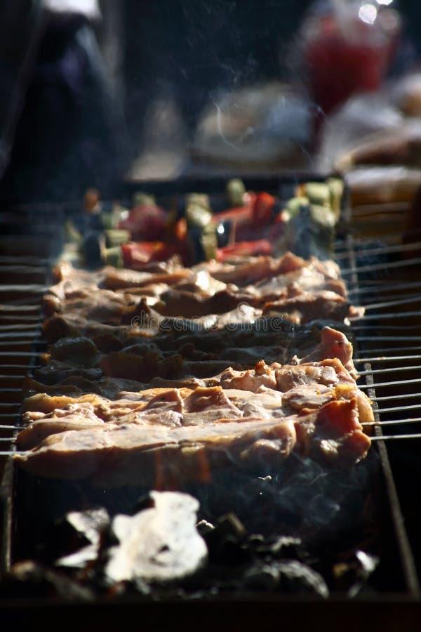 Shashlik on charcoal grill close up stock image