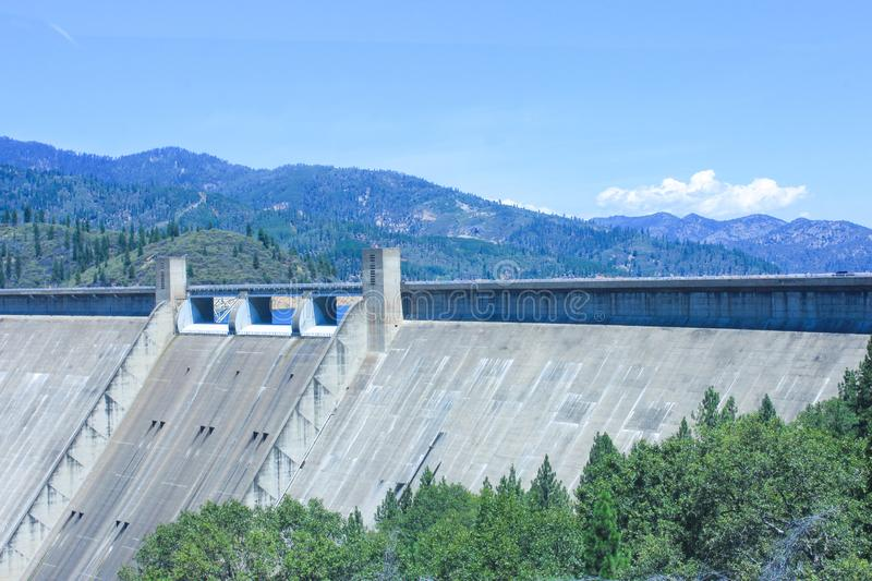 Beautiful view of the Shasta Dam, California, USA. Shasta Dam also known as Kennett Dam is a concrete arch-gravity dam across the Sacramento royalty free stock image
