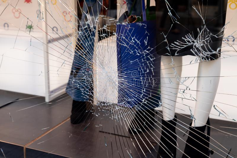 Shattered window of broken storefront store crack from impact on shop glass boutique stock photography
