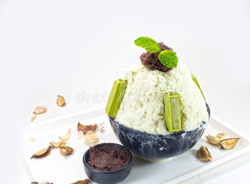 Shaved ice with milk, chocolate, green tea. royalty free stock photos