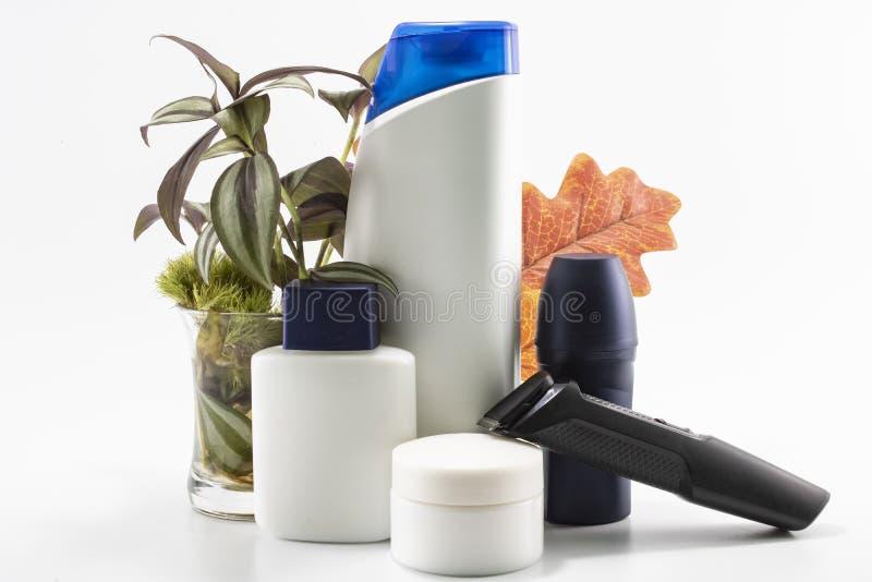 Shaver, soap, shampoo, deodorant, cream set. stock image