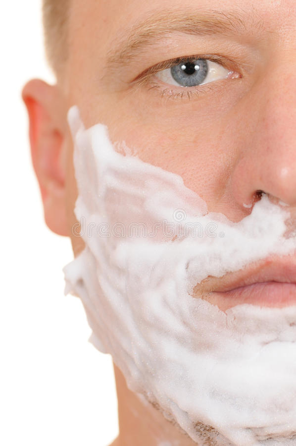 Shaving. The man has a shave isolated on white background stock photo