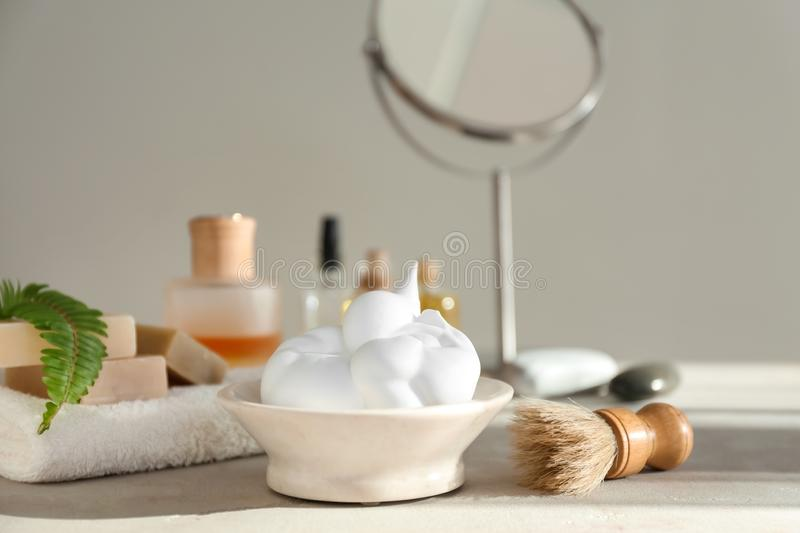 Shaving accessories on table in bathroom stock images