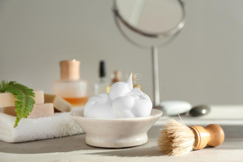 Shaving accessories on table in bathroom royalty free stock photos