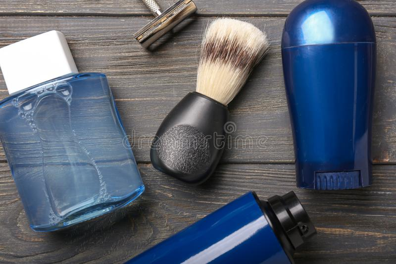 Shaving accessories on wooden background, flat lay royalty free stock photography
