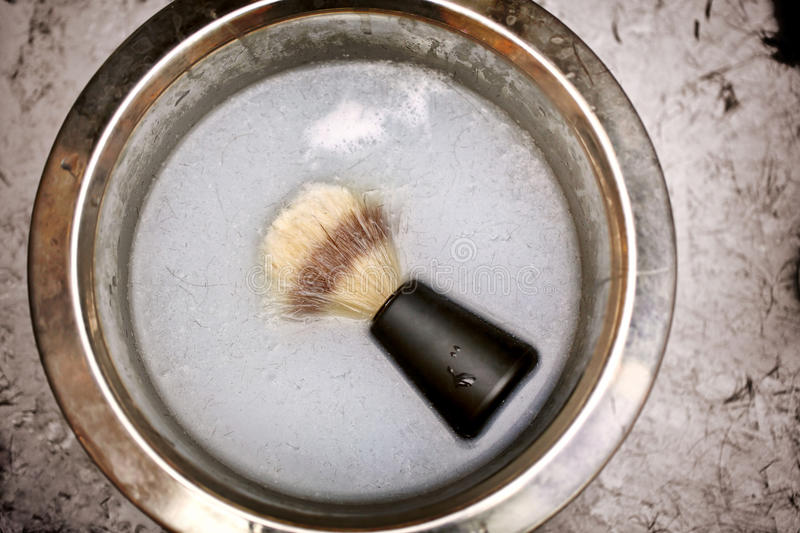 Shaving brush in a bowl in barber shop royalty free stock image