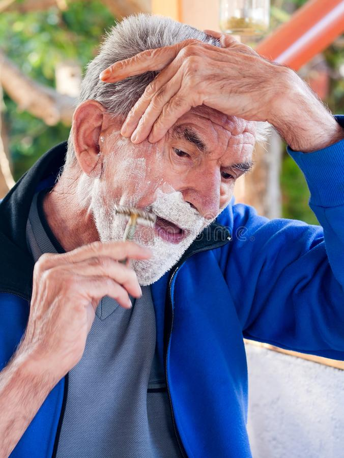 Shaving elderly man stock images