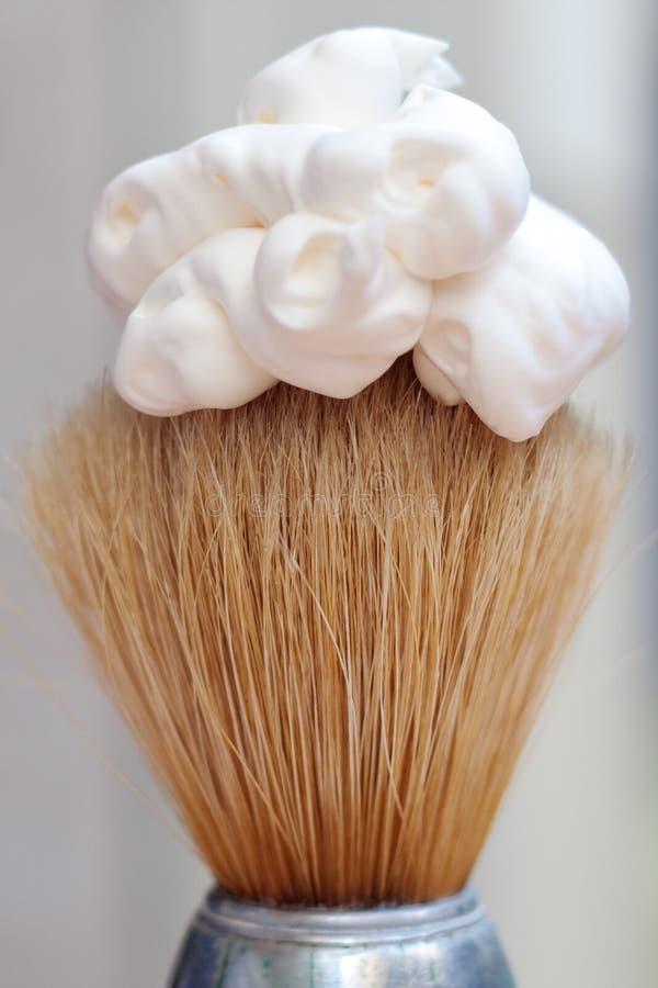 Shaving foam on brush. Shaving foam on natural bristle brush stock image