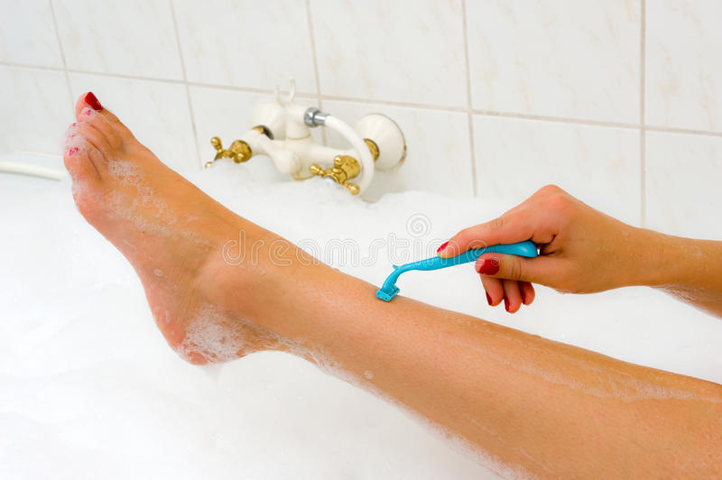 Download Shaving her legs stock photo. Image of bathroom, remover - 34244918