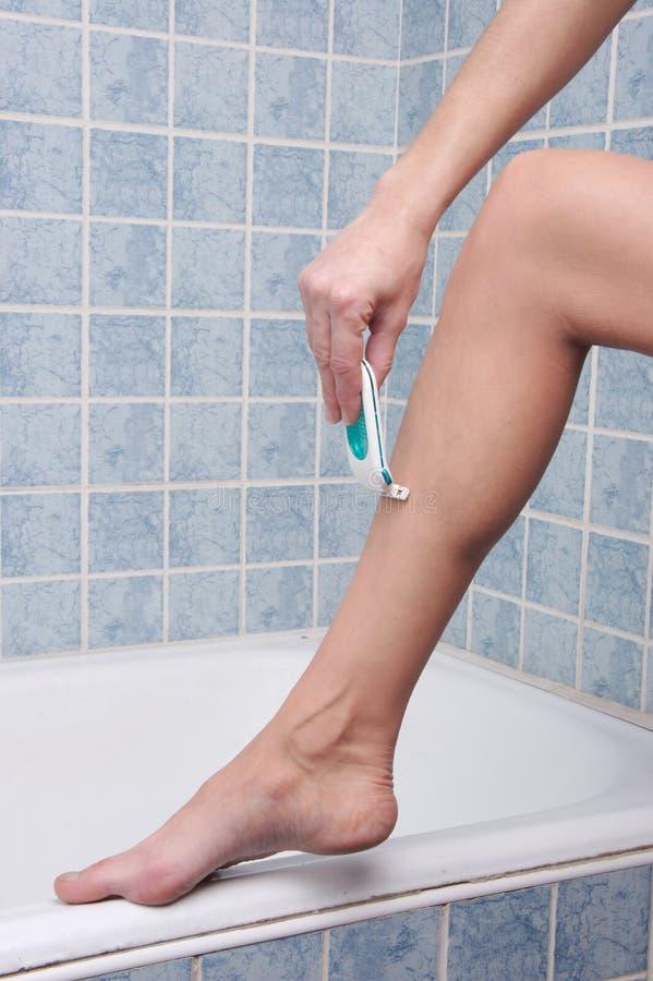 Shaving Legs 1 royalty free stock images