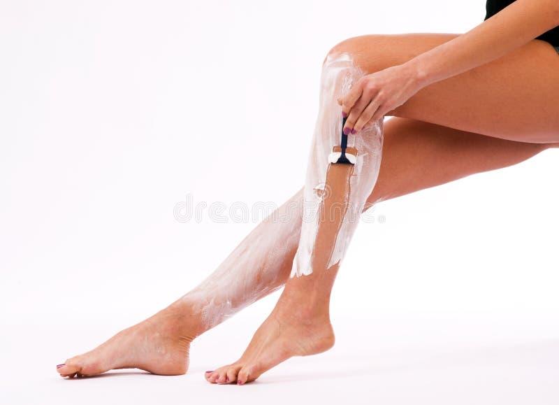 Beautiful Slander Woman Shaving Legs Cream stock photo