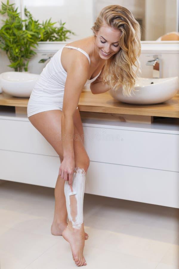 Shaving Legs Stock Photo