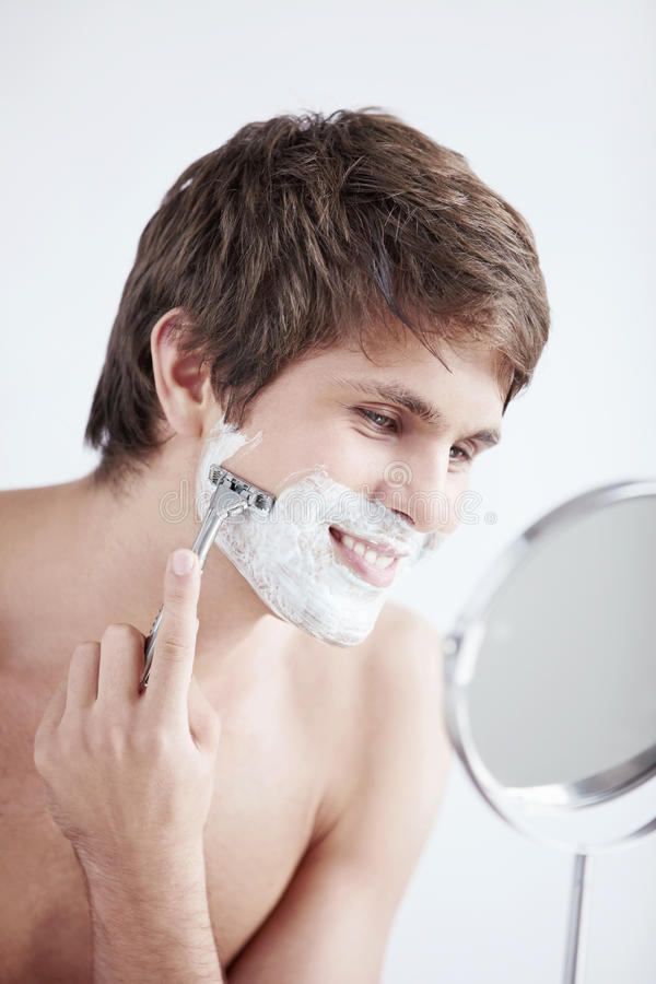 Shaving a man stock image