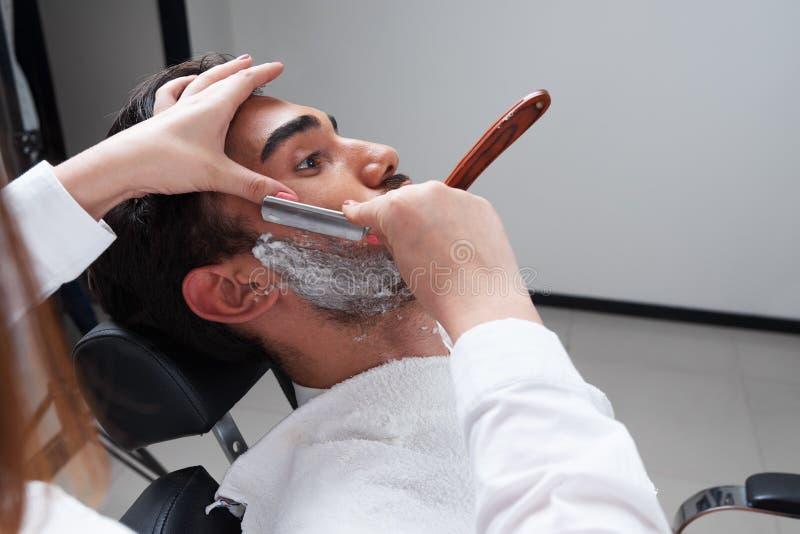 Shaving process Barbershop face closeup royalty free stock images