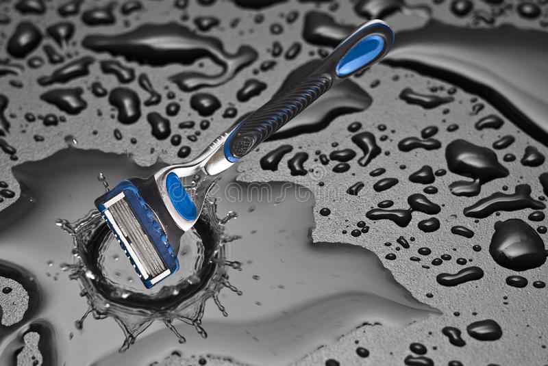 Download Shaving Razor Inside A Drop Of Water Stock Image - Image: 30225465