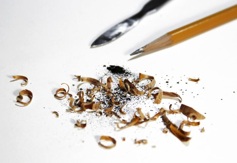 Shavings and pencil on a white background stock photography