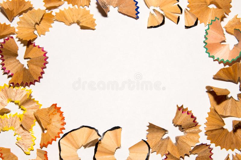 Shavings from a pencil on a white sheet of paper. On white background. Design. royalty free stock photos
