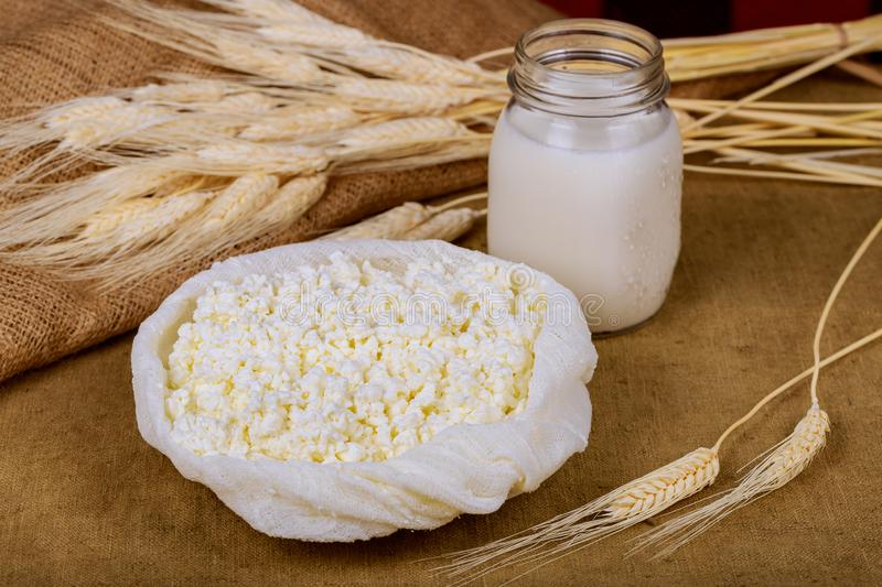Shavuot kosher food fresh dairy products milk, cottage cheese wheat. Harvest festival holiday jewish holidays kippa healthy eating judaism rural grain royalty free stock image