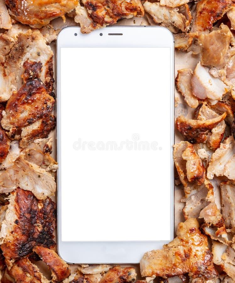 Shawarma, compas gyroscopiques, ordre en ligne Nourriture de turc et grecque traditionnelle de viande et un téléphone portable images libres de droits