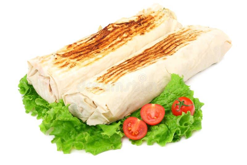shawarma con la lechuga aislada en el fondo blanco Alimentos de preparación rápida imagen de archivo libre de regalías
