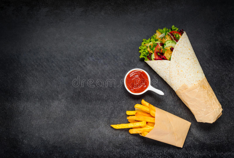 Shawarma with French Fries and Ketchup on Copy Space royalty free stock images