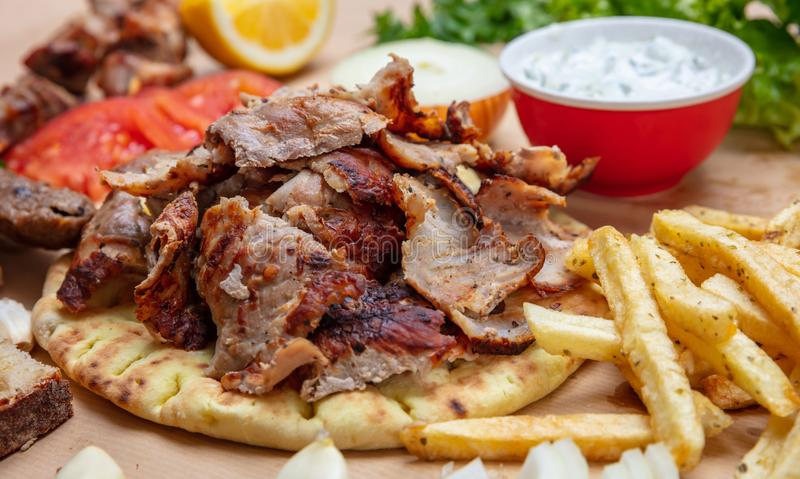 Shawarma, gyros pita. Traditional turkish, greek meat food on pita bread royalty free stock photos