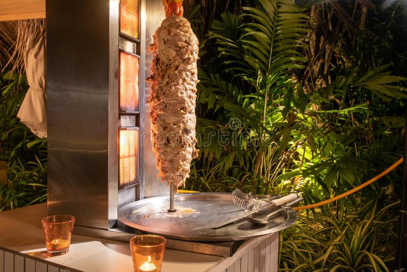 Shawarma meat at the international cuisine dinner outdoor setup at the tropical island restaurant royalty free stock images