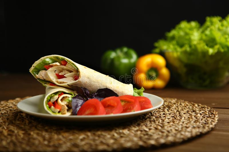 Shawarma, roll with chicken, salad in pita bread royalty free stock photo