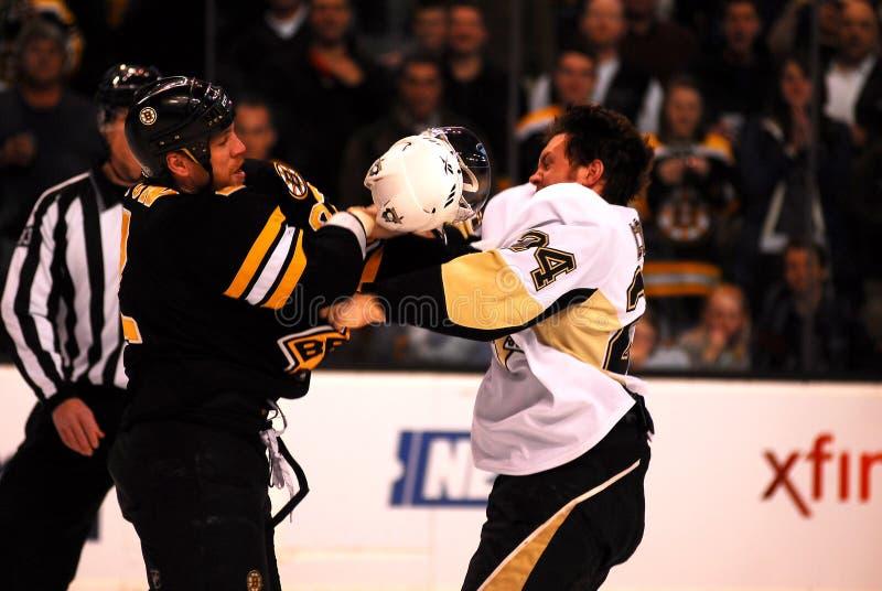 Shawn Thornton and Matt Cooke fight. Boston Bruins (F) Shawn Thonton (black jersey) and Pittsburgh Penguins (F) Matt Cooke battle it out in Boston royalty free stock image