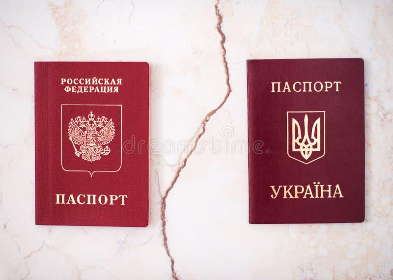 Shchelkovo, federacja rosyjska - Mar 09, 2019: Dwa cudzoziemskiego paszporta mieszkana Ukraina i federacja rosyjska zdjęcie royalty free