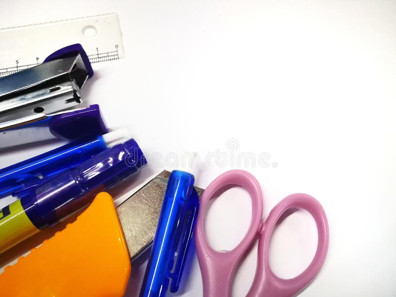 Shcool articles on white background. Shcool articles white background staplers pensil scissors stationery royalty free stock photo