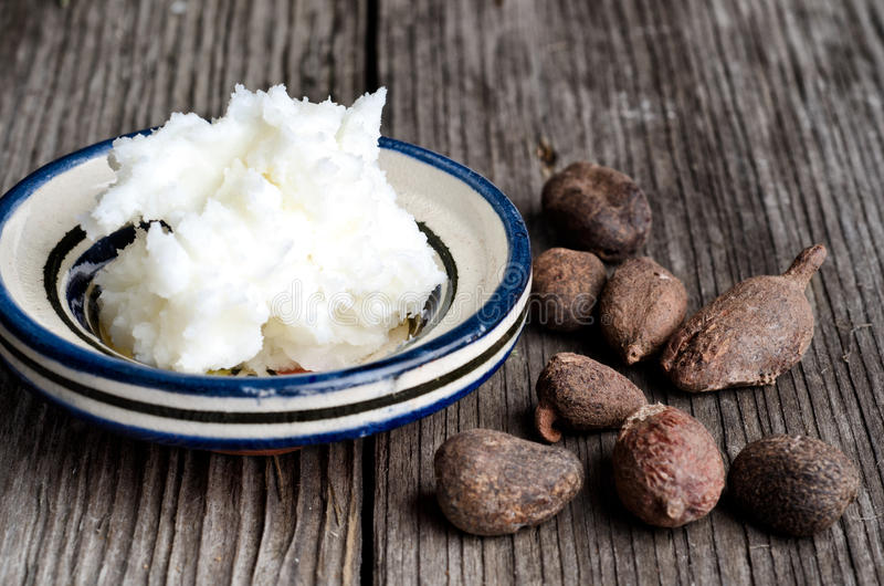 Shea butter and shea nuts royalty free stock photos