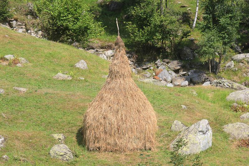 Sheaf of straw in mountain stock photo