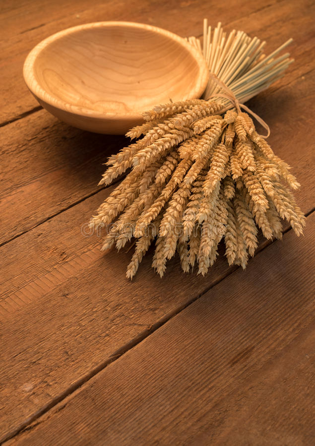 Sheaf of wheat. On rustic table stock photography