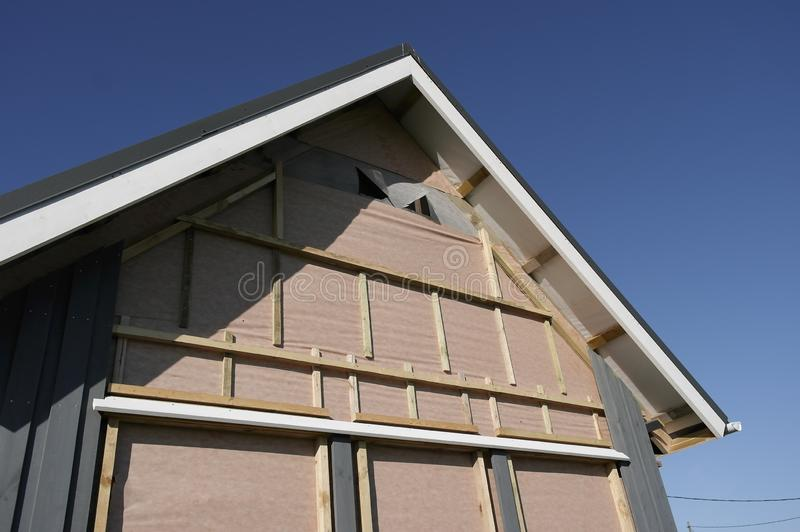 The sheathing of a frame house boards, Scandinavian style royalty free stock photos