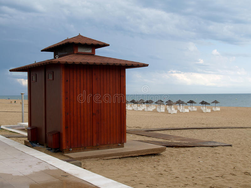 Shed on empty beach. With cloudy sky royalty free stock image