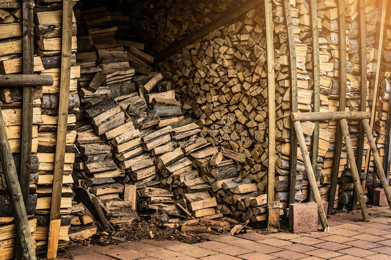 Shed with fire wood for the fireplace stock photography