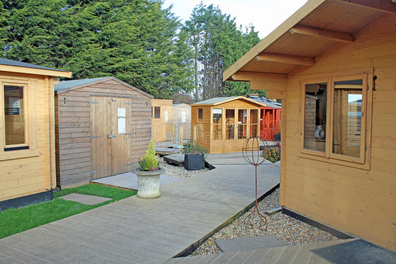 Sheds And Chalets. This photo shows a collection of chalet style sheds and log cabins stock photos